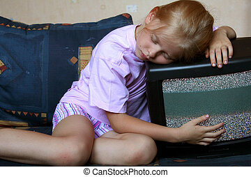 Watching TV - Little girl sleeping on TV set