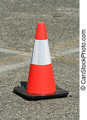 Red and white plastic traffic safety cone