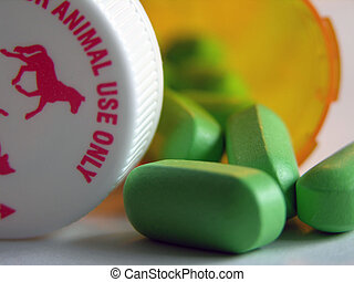 Green pills - close up of green pills