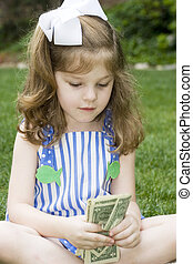 Counting my money - Expressive girl with a bunch of money