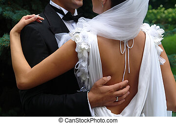 hold me tight - groom and bride holding each other
