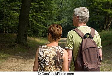 senior couple hiking -2 - senior couple hiking in the woods