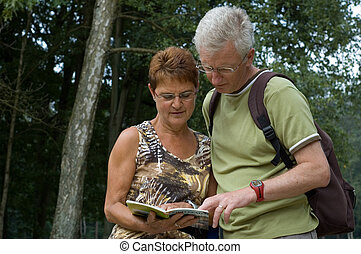 Is this the right way? - Active senior couple on a hike.