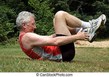 Stretching Man - A senior man is stretching after a long run