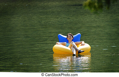 Relaxin\\\' - woman  floating on water