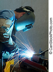 Welder at work - Welder working on metal tubes