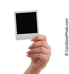 hand with polaroid frame