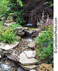 Oriental Falls - Small stepped waterfall in a landscaped...