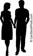 Couple walking - Silhouette of a couple walking hand in hand