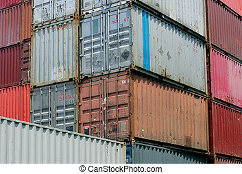 Shipping containers waiting to be loaded on a cargo ship
