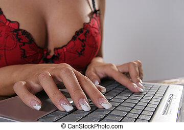 Hot office - Lady writing in bra on a notebook