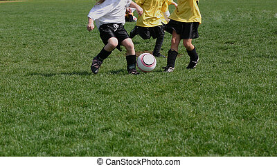 Soccer trio - Trio of youth soccer players taking soccer...