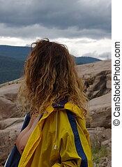 Rain Gear 5 - Topless female model wearing a rain coat...