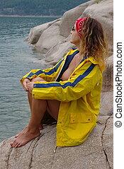 Rain Gear 6 - Semi nude female model wearing a rain coat by...