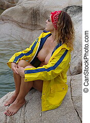 Rain Gear 7 - Semi naked female model on a rock by the sea...