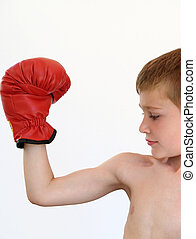 boy boxer making a muscle - boy making a muscle with a red...