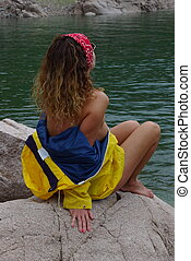 Rain Coat 14 - Female modelling a yellow rain jacket by the...