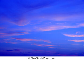 Sunset in Deep Blue - A deep blue sky with peach and pink...
