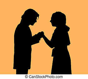 Proposal - Man and woman, in silhouette, holding hands and...