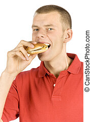 man eats burger - isolated man eats burger