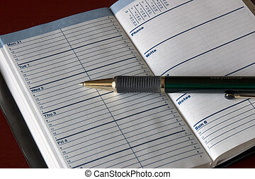 date book - blank pages of weekly date book with pen