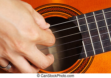 Guitar player - Close up on a man playing guitar