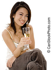 Asian Girl - A pretty young asian woman sitting drinking...