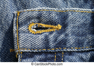 Denim Button Hole - Closeup of a button hole on a pair of...