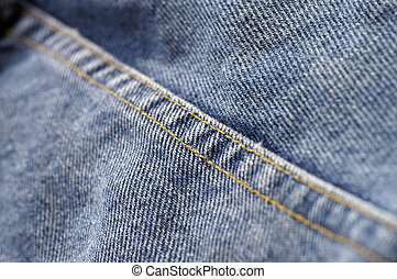 Denim Seam - Closeup of a seam on denim blue jeans