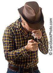 Lighting up - cowboy lighting a cigarette