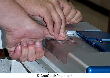 Busted - a mans hands getting finger printed