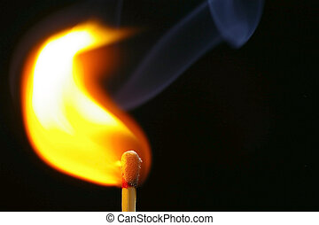 Igniting Match - Closeup of a red-tipped wooden match stick...