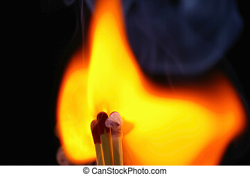4 Igniting Matches - Closeup of four (4) red-tipped wooden...