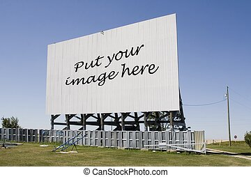 Drive-In Screen - A vintage drive-in movie screen with a...