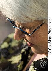 portrait of elderly woman - elderly woman in dark glasses