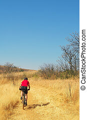 mountainbiking 6 - Lone racer on his mountainbike - Copy...