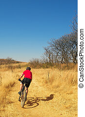 mountainbiking 7 - Lone racer on his mountainbike - Copy...