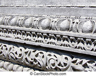 Stone ornament on ancient construction