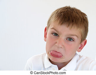 boy making silly face - young boy making a silly face