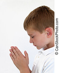 Praying Boy - Young boy praying with hands together