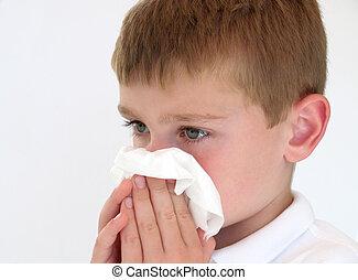 boy sick - sick boy blowing his nose