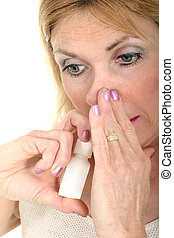 Use Nasal Spray Hand - Woman demonstrates using nasal spray...
