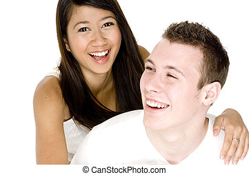Fun Couple - A young couple in love share a joke and a smile