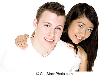 Couple Together - A young man and woman wearing white on...
