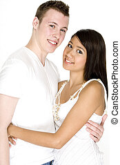 Young Couple Together - A teenage couple wearing white on...