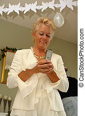 Mature lady on a party sending SMS - Mature lady sends an...