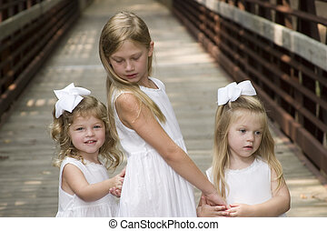 Sisters - Twin Sisters and older sister
