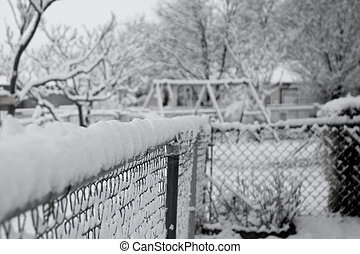 Snow - A snow covered fence in black and white