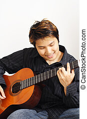 Guitar player - A handsome man playing guitar