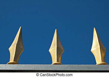 Golden spikes - Ornate fence in Helsinki